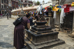 Religious activities and ceremony happening at around the famous attraction Buddhist Shrine Boudhanath Stupa, Kathmandu, Nepal. Royalty Free Stock Images