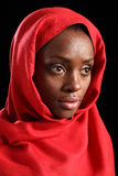 Religious african amercian woman in red headscarf. Peaceful and serene portrait of beautiful young black african american woman wearing red headscarf, taken Stock Images