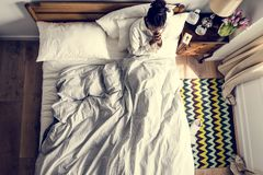 Religious African American woman on bed praying Royalty Free Stock Photography