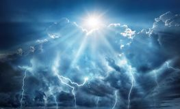 Free Religious And Scientific Apocalyptic Background. Dark Sky With Lightning And Dark Clouds With The Sun That Represents Salvation Stock Image - 138510121