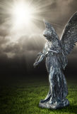 Religious angel. A photography of a religious angel under a dark sky Royalty Free Stock Images