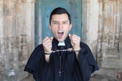 Religious angry man handcuffed portrait.  stock photography