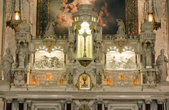 Religious artwork church altar. Details of elaborate carvings and religious artwork on an ornate, highly decorated Catholic church altar Stock Photo