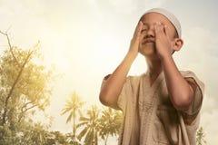 Religious asian muslim boy praying to god Royalty Free Stock Photos