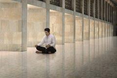 Religious asian muslim man with prayer beads praying Royalty Free Stock Image