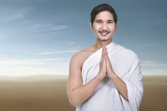 Religious asian muslim man praying. With desert background Royalty Free Stock Image