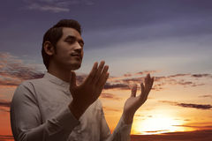 Religious asian muslim man praying to god Stock Photography