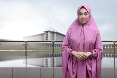 Religious asian muslim woman wearing veil with clasping hand sta Stock Photography