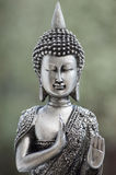 Religious Asian sculpture. A beautiful Asian style silver religious sculpture Royalty Free Stock Images