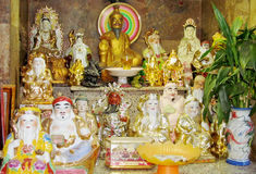 Religious asian statues in a temple Stock Image