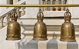 Religious bells in temple Stock Images