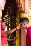 Religious blessing at Kailashnath Mahadev Statue complex in Sanga, Nepal