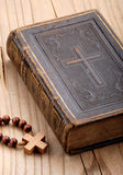 Religious book. With rosary on the wooden table stock photography