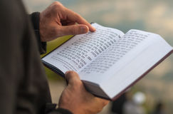 Religious book Mahzor. Rosh Hashanah. UMAN, UKRAINE SEPTEMBER 15, 2015: Man holding Mahzor - prayer book used by Jews on the High Holidays of Rosh Hashanah and Stock Images