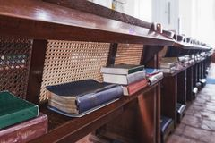 Religious books in St Andrew Cathedral, Singapore. Singapore - January 19, 2018: Religious books in different languages lie on the shelves in the St Andrew `s stock image