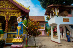 Religious building in Laos. Gold decor, a beautiful temple with statues in the small town of Laos Stock Photos