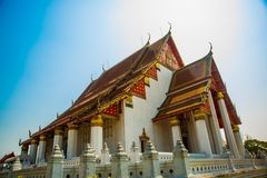 Religious building with a triangular roof on blue sky background. Ayutthaya Thailand. Royalty Free Stock Photography