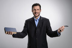 Religious businessman. Cheerful bearded man in formalwear holdin Royalty Free Stock Images