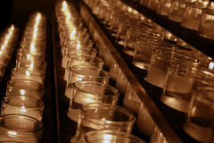 Religious Candles. Rows of lit candles in a catholic church Royalty Free Stock Photography