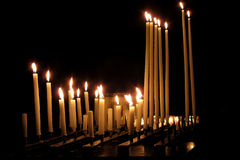 Religious Candles Burning in a Dark Church royalty free stock image