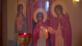 Religious candles burning with icones stock footage