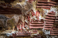 Religious carving in  Buddhist Kaw Goon cave. Hpa-An, Myanmar (B Stock Photos