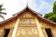 Religious carvings on the chapel of Wat Xieng Thong, Laos Stock Image