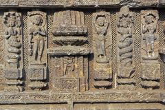 Religious Carvings on Konark Temple. Detail of religious carvings decorating the  ancient Surya Hindu Temple at Konark, Orissa, India. 13th Century AD Royalty Free Stock Image