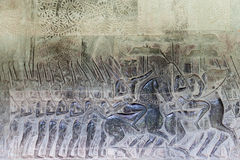 Religious carvings on the walls of Angkor Wat Royalty Free Stock Photography
