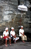 A religious celebration in Bali, Indonesia. Group of three men in a religious ceremoy in Bali, Indonesia Stock Photography