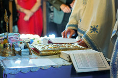 Religious ceremonial. Orthodox religious ceremonial with priests books and people on the side Stock Photo