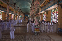 Religious ceremony in Cao Dai Temple Stock Photo