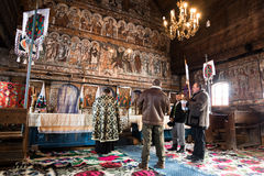 Religious ceremony. A small religious ceremony in an old church in Maramures, Romania Stock Images