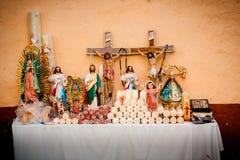 Religious Christian Catholic objects displayed. Cristo, Virgen G Stock Photo