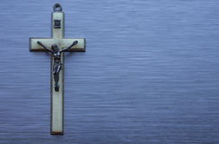 Religious christian cross brushed metal Stock Photography
