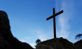 Religious christian cross standing on rock on the mountain. Concept or conceptual religious christian cross standing on rock on the mountain over beautiful vector illustration