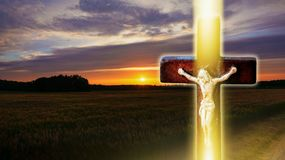 Religious christian cross with sunset sky . Christian cross on sunset background . Way to God . bright light from heaven . Religious background royalty free stock photos
