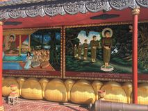 Religious colorful 3-dimensional relics on the walls of Wat Preah Prom Rath Temple in Siem Reap, Cambodia Stock Photo
