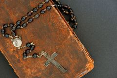 Religious concept: cross and Bible. Old silver cross on Holy Bible Royalty Free Stock Images