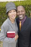 Religious Couple with Bible in garden Stock Photo