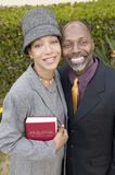 Religious Couple with Bible in garden portrait high angle view stock photo