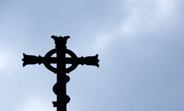 Religious Cross on clear sky Stock Photography