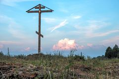 Religious cross on the field Stock Images