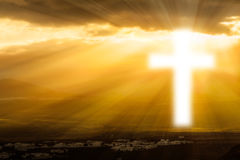 Religious cross  glowing in heaven Royalty Free Stock Photos