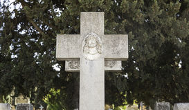Religious cross on a grave Royalty Free Stock Images