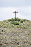 Religious cross on a hill. Mound or burial site representation of christian catholic christianity Royalty Free Stock Photography