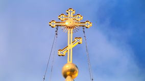 Religious cross with loopable sky background stock footage