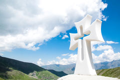 Religious cross in the mountains Stock Image
