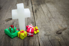 Religious cross with presents Royalty Free Stock Images