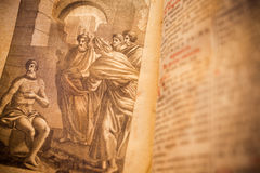 Religious drawing from a 300 years old roman book in latin language. Creative editing to give the ancient aspect stock images